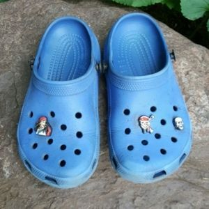 Blue Crocs with charms